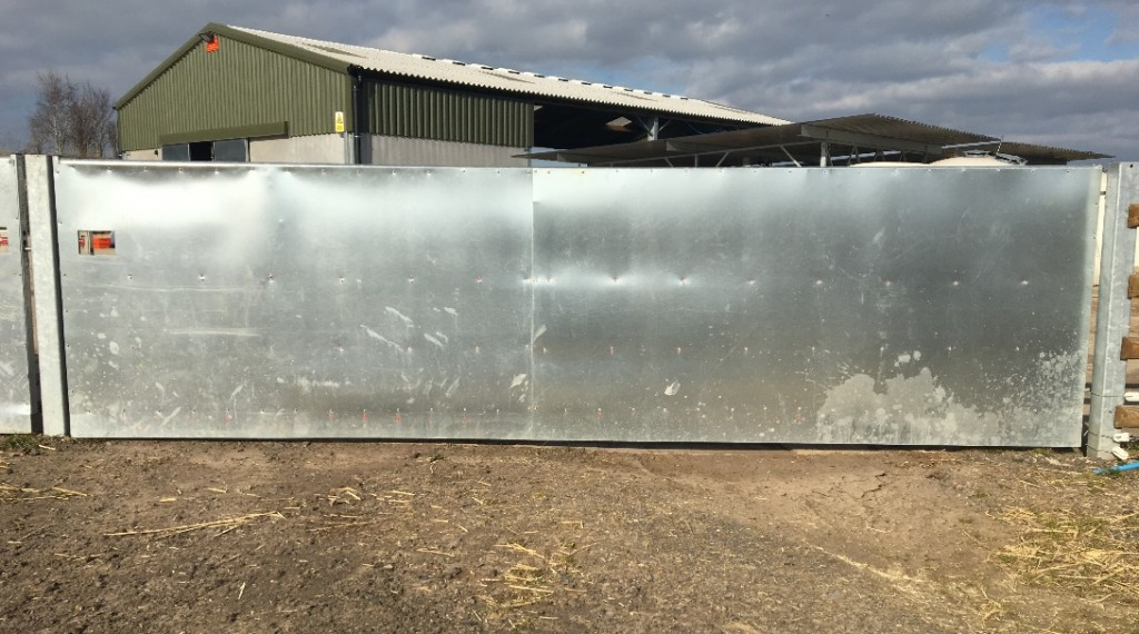 Badger proof gates protecting farm buildings - Bovine TB